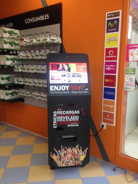 Kiosco de fotos con canalización lotería, recargas, liberaciones…